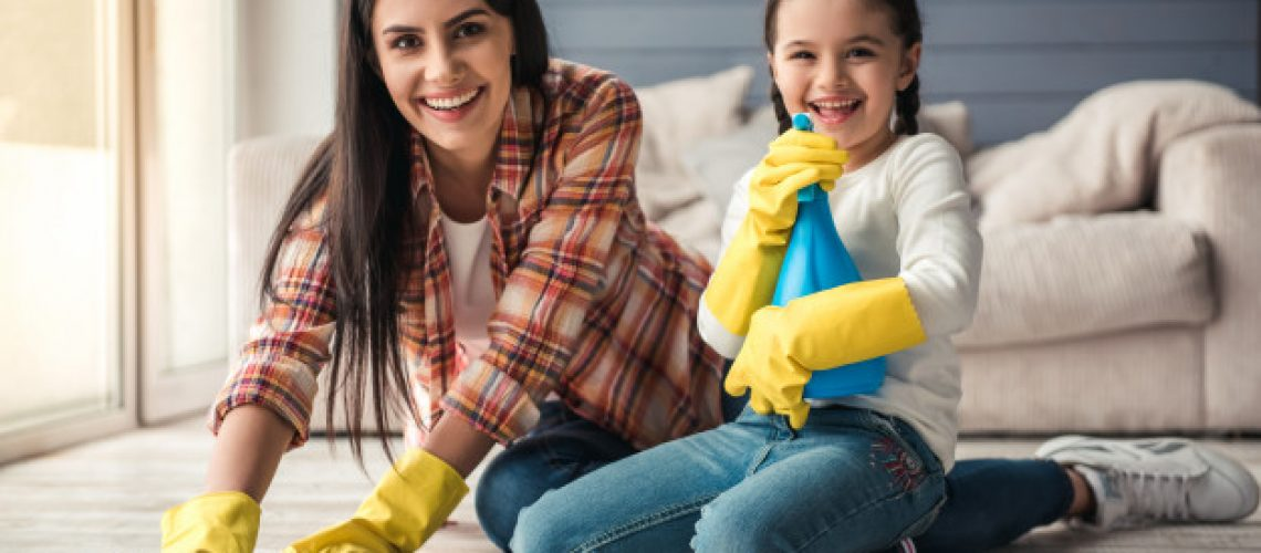woman-her-daughter-are-smiling-while-cleaning-floor_85574-6218